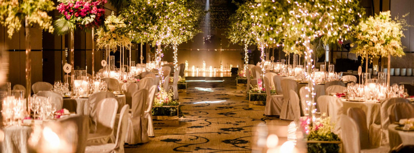 Candlelight and forest greens for the aisle with love and blessing.